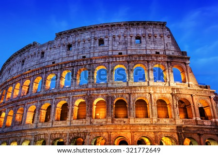 Colosseum in Rome, Italy. Symbol of the ancient city. Amphitheatre illuminated at night - stock photo
