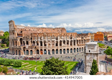 Colosseum in Rome, Italy with tourists on sunny bright day. The Colosseum was built in the 70s AD and was the largest amphitheatre built during the Roman Empire. Major Italian landmark. - stock photo