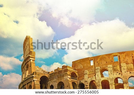 Colosseum in Rome with blue sky - stock photo