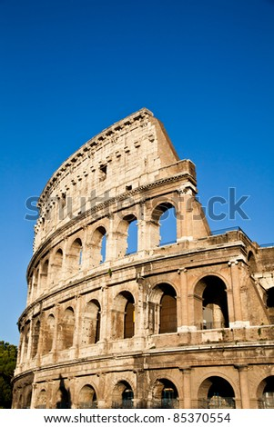 Colosseum in Rome with blue sky, landmark of the city - stock photo