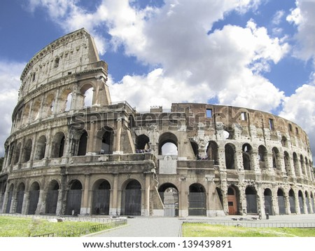 Colosseum in Rome with blue sky with clouds - stock photo