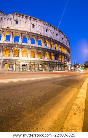 Colosseum in Rome with car lighting, Italy - stock photo