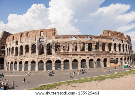Colosseum is an elliptical amphitheatre in the centre of the city of Rome, Italy. - stock photo
