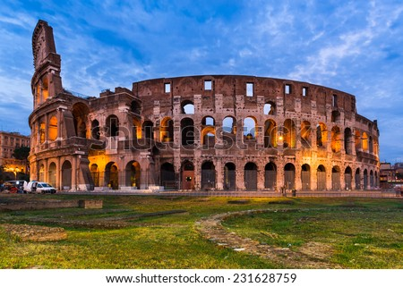 Colosseum, Italy. Twilight view of Colosseo in Rome, elliptical largest amphitheatre of Roman Empire ancient civilization. - stock photo