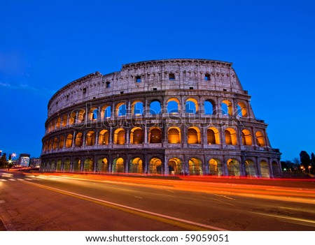 Colosseum or Coloseum at dusk from in front of Metro night, Rome Italy - stock photo