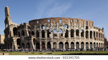 Colosseum, Rome, exterior, sunny day with crowds of visitors - stock photo