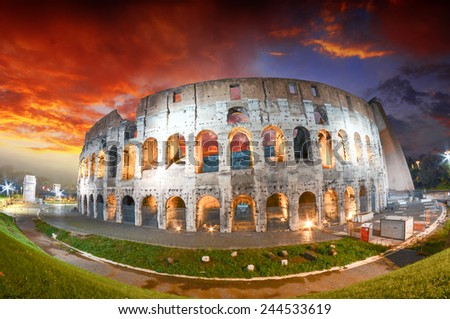 Colosseum - Rome. Night view with surrounding grass and park. - stock photo