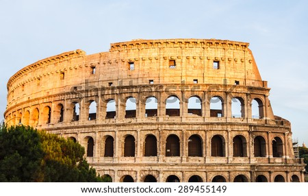 Colosseum with evening sunlight before sunset in Rome.