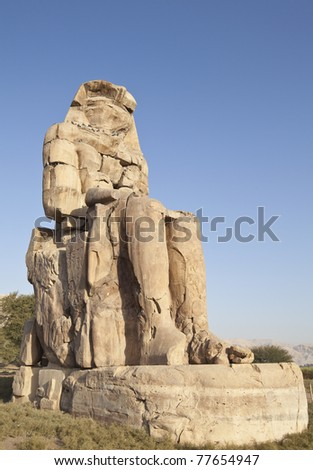 Colossi of Memnon huge statues guarding the valley of the kings Egypt