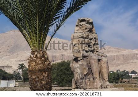 Colossi of Memnon statues in Luxor, Egypt - stock photo