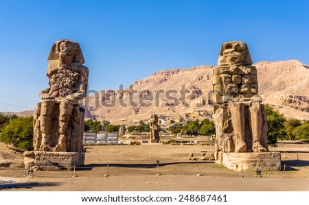 Colossi of Memnon (statues of Pharaoh Amenhotep III) near Luxor - Egypt - stock photo