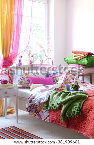 colour bedroom modern interior green blanket and orange curtain behind window - stock photo