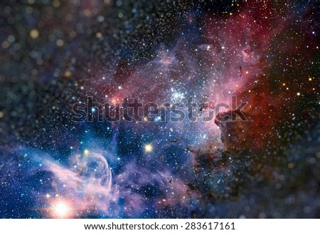 Colour-composite image of the Carina Nebula, revealing exquisite details in the stars and dust of the region. Retouched image with small DOF. Elements of this image furnished by NASA. - stock photo