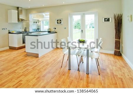 colour image kitchen in newly restored rebuilt house work surfaces - stock photo