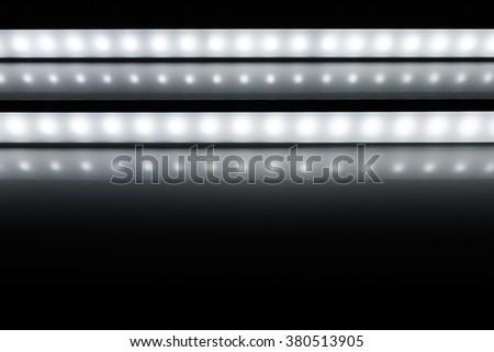 colour of led rigid strip lighht : two of led light line on white - stock photo