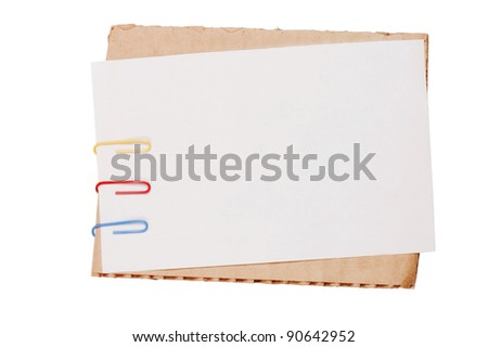 Colour paper with a paper clip isolated