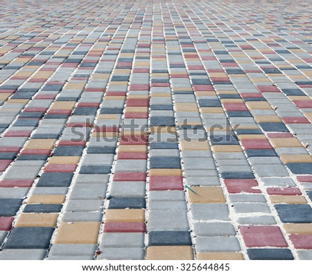 colour paving slabs extending to the horizon in the background - stock photo