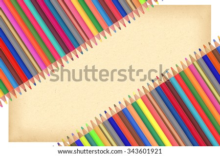 Colour pencils and paper isolated on white background - stock photo