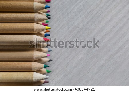 Colour pencils, colored pencils lay in a heap, school design, items for school design, colored flat education tools, articles for writing, art, drawing, copyspace    - stock photo