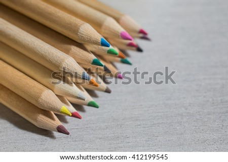 Colour pencils, colored pencils lay in a heap, school design, items for school design, colored flat education tools    - stock photo