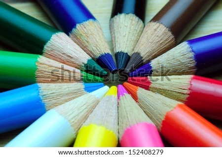Colour pencils isolated on wood