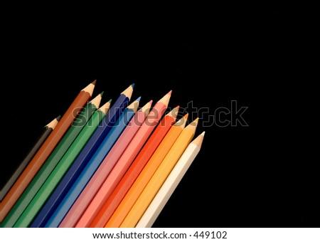 colour pencils on black background - stock photo