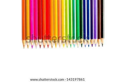 Colour pencils on white background close up - stock photo