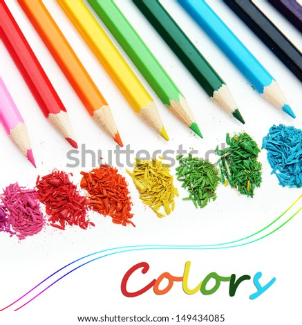 Colour pencils with sharpening shavings isolated on white