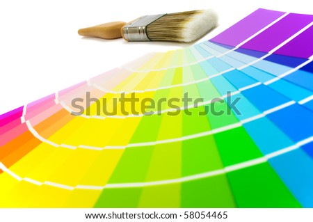 Colour swatches with paint brush - focus on brush at rear - stock photo