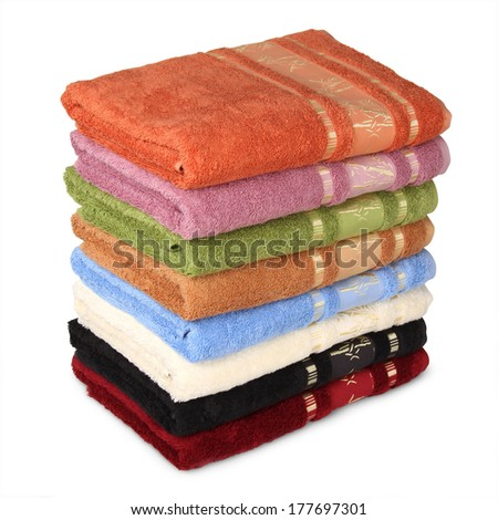 Colour terry towels combined by pile on white background. Isolated.  - stock photo