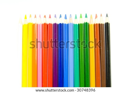 Coloured crayon line up side by side