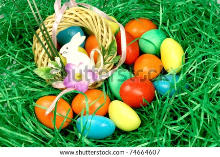 coloured eggs in the grass rabbit with decoration - stock photo