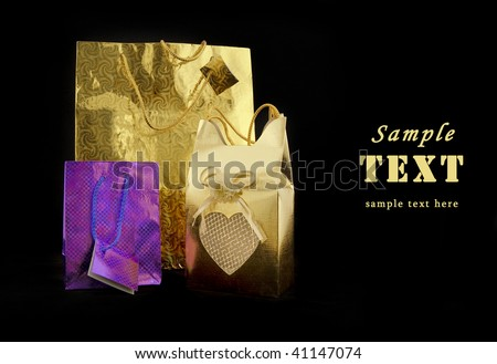 Coloured gift packages on a black background