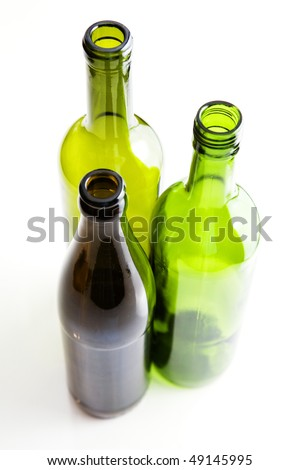 Coloured glass bottles on white background