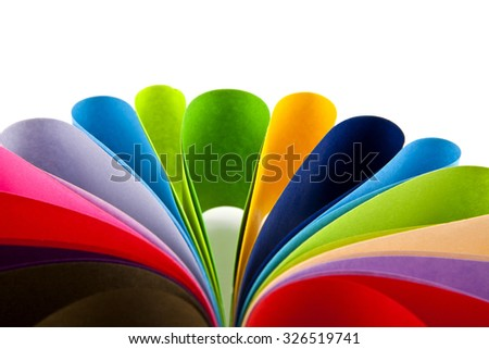 coloured paper on a white background - stock photo