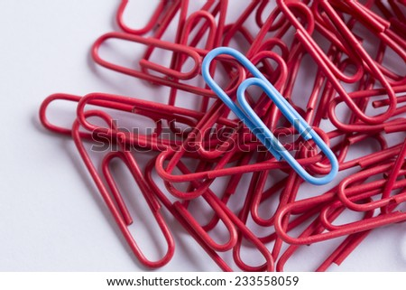 coloured paperclips on a white surface  - stock photo