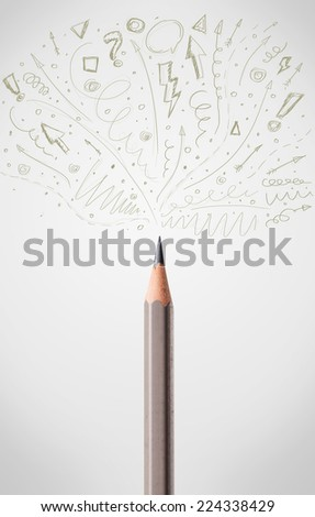 Coloured pencil close-up with sketchy arrows - stock photo