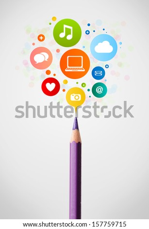 Coloured pencil close-up with social network icons - stock photo