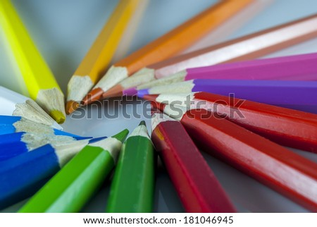 coloured pencil in group on white background