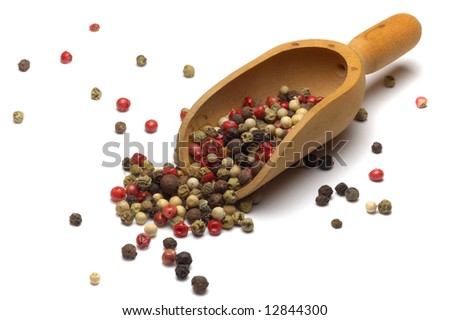 Coloured pepper on a wooden spoon isolated on white