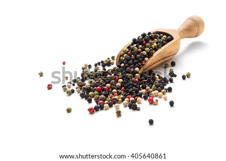 Coloured pepper on a wooden spoon isolated on white - stock photo