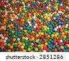coloured plastic balls in bouncy castle - stock photo