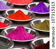 Coloured powders at market in Orchha, India - stock photo