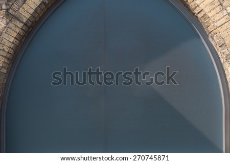 Coloured sign board on a trade building - stock photo