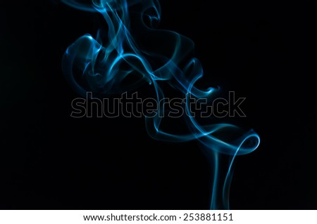 Coloured smoke isolated in black background - stock photo
