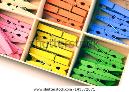 Coloured wooden cloth pins set in the box,process in vintage stlye - stock photo