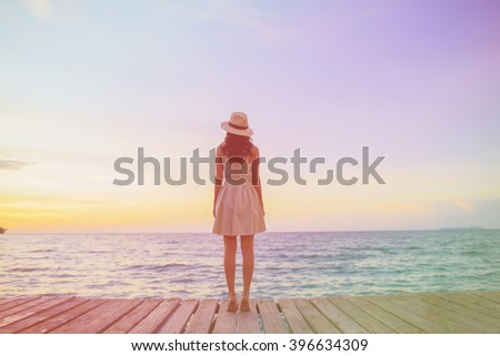 Colourful A young woman stands on the beach during a beautiful Location. vacation vitality healthy living concept. - stock photo