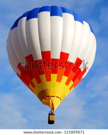 Colourful air balloon flying at the end of day