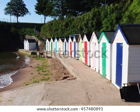 stock-photo-colourful-beach-huts-on-a-se
