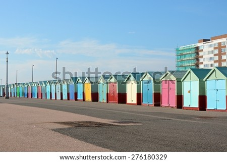 Colourful beach huts on the promenade at Hove in Brighton, East Sussex, England